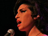Winehouse grabs Grammy glory
