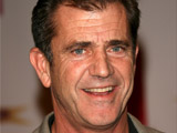 Mel Gibson walks red carpet with new love