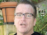 Tom Arnold stands in for Schwarzenegger