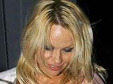 Pamela Anderson moves into a caravan