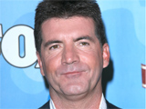 Cowell plays 'Guitar Hero' in bedroom