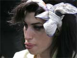 Winehouse 'threw drink over woman'