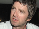 Oasis 'weirded out' by concert banner