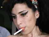 Winehouse dad flies to 'tormented' singer