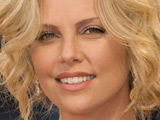 Charlize Theron 'would love to be a mom'