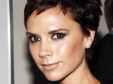 Victoria Beckham strips for Armani