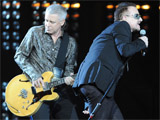 U2 hold Lennox, Clarkson off albums No.1