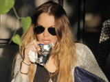 Lohan 'celebrates' split with new tattoo