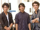 Jonas Brothers 'bring bodyguards on dates'