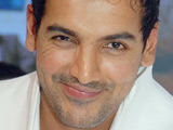 John Abraham helps charity build homes