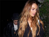 Ronson 'breaks up with Lohan via text'