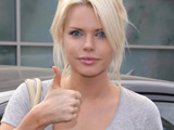 Sophie Monk in pain after car accident