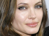 Jolie bakes cake with help from TV show