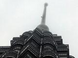 Alain Robert climbs Petronas Twin Towers