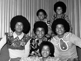 Jacksons 'always feel brother's presence'