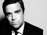Robbie: 'Oasis deserve Brit award'